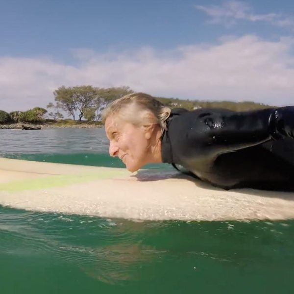 old woman surfing